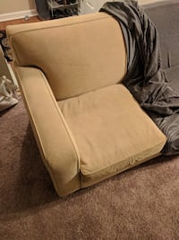 Tan Sofa and Loveseat with covers Concord