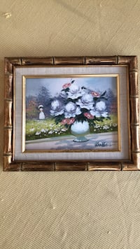 Oil painting signed on board with frame of floral scene West Palm Beach, 33407