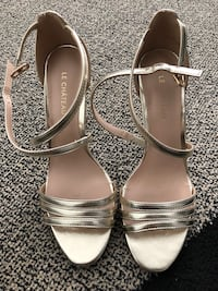 pair of white leather open-toe ankle strap heels Vaughan