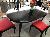 round black wooden table with chairs Houston, 77067