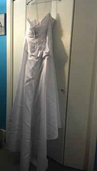 Women's white strapless wedding dress size 12 purchased from Davids Bridal wore 1 day dry cleaned and stored in smoke free house.  Beautiful dress waiting for you!! Depew, 14043