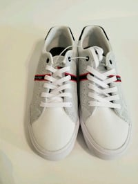 pair of white low-top sneakers Woodbridge, 22191