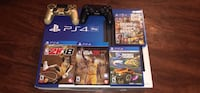 black Sony PS4 console with controller and game cases Lebanon, 17042