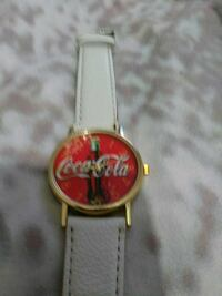 round gold analog watch with white leather strap Eastpointe, 48021