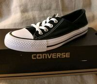 unpaired black and white Converse All Star low top sneaker Brownsville