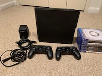 PlayStation 4 Slim 1TB W/ 2 controllers and games
