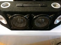 two round gray subwoofers with black enclosure Albuquerque, 87113