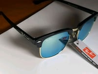 blue sunglasses with black frames 483 km