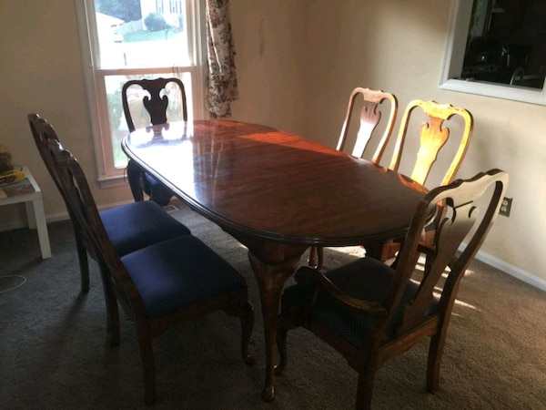 oval brown wooden table with six chairs dining se