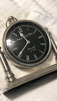 Imperial clockworks silver table clock