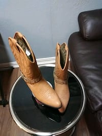 pair of brown leather cowboy boots Dallas, 75219
