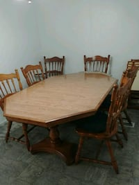 rectangular solid wooden table with six chairs din Santee, 92071