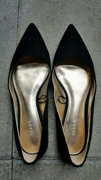 pair of black leather flats Coquitlam, V3B 6E8