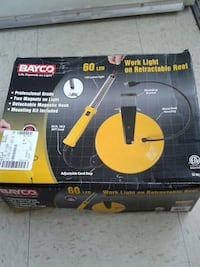 Bayco work light on retractable reel box