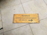 brown wooden board with notice complaint department-printed signage
