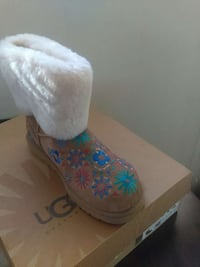 white and brown floral ugg boot