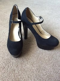 pair of black suede platform mary jane shoes