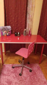 Table and pink office chair
