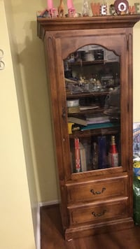 brown wooden framed glass display cabinet Baltimore, 21224