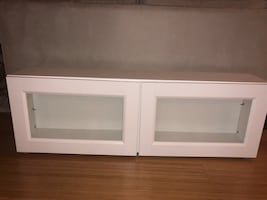 White wooden 2-door cabinet, with partitions for shelving