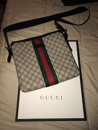black and brown Gucci crossbody bag 786 km