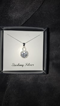 Brand new sterling silver beautiful necklace with flower pendent shines beautiful. Retail price $90 selling for $25