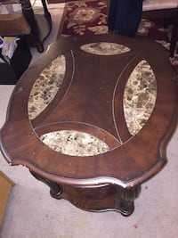Brown wooden framed glass top coffee table Washington, 20010