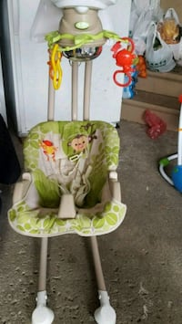 baby's green and white bouncer Mississauga, L4Z 2N7
