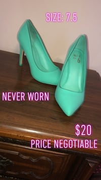 Pair of teal leather pointed toe stilettos Lafayette, 70506