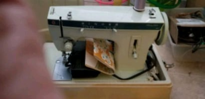 Singer sewing machine with sewing table