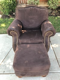 brown wooden framed black padded armchair