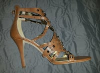 pair of brown spike studded leather heeled strappy