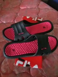 pair of black-and-red slide on sandals