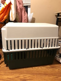 Green and white pet carrier 427 mi