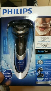 black and blue Philips Norelco shaver Cambridge, N1S 2W5