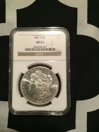 round silver and gold coin New York, 10458