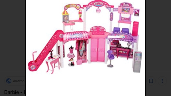 purple and pink plastic castle toy
