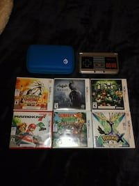 blue Nintendo 3DS with game cases Kitchener, N2R 1P6