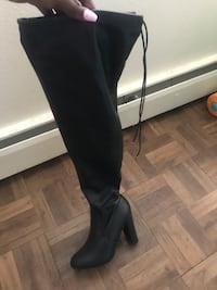 pair of black leather knee-high boots Colorado Springs, 80906