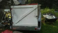 white and black utility trailer 681 km