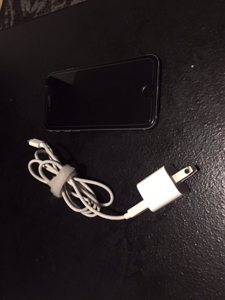 black iPhone 7 with charger for sale  Laval