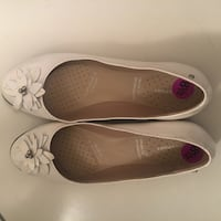 pair of white leather flats Calgary, T2Z 0Y7