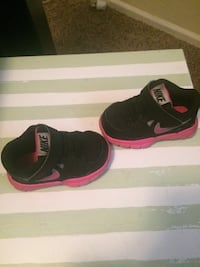 children's pair of black-and-pink Nike sneakers
