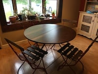 round brown wooden table with four chairs dining set Kendall Park, 08824