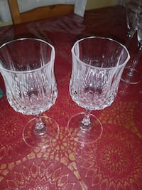 two clear cut glass cups