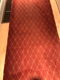 2 Dark maroon wool hall rugs ..9 ft by 3 ft & 17ft by 31 inches.. make an offer