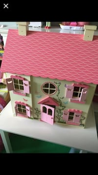white and pink dollhouse toy 799 km
