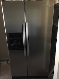 gray side-by-side refrigerator with dispenser Hurst, 76053