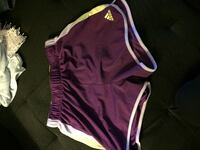 purple and white Nike shorts