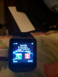 black smartwatch with black strap Montreal, H1S 2M9